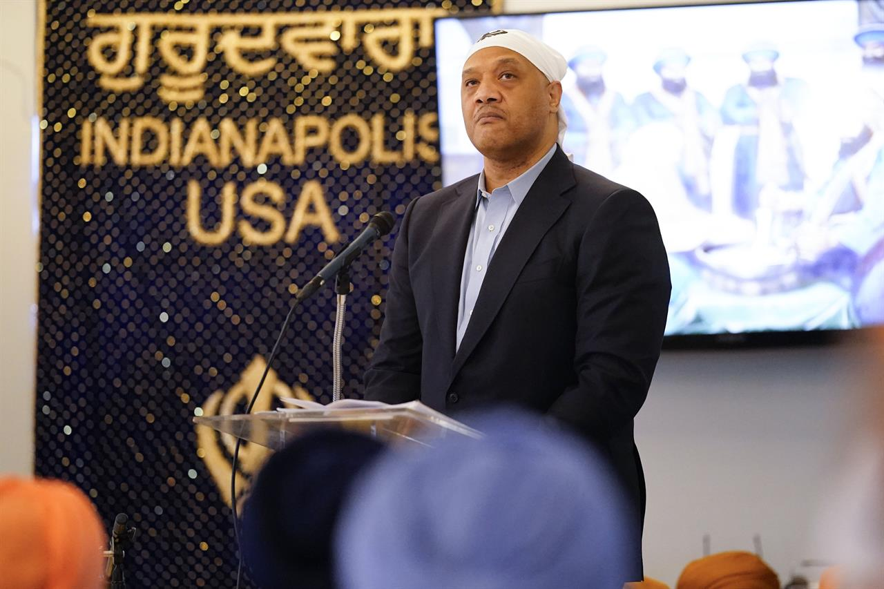 Rep. Andre Carson, D-Ind., speaks with members of the Sikh Coalition at the Sikh Satsang of Indianapolis in Indianapolis, Saturday, April 17, 2021, for a commemoration of the victims of the shooting at a FedEx facility in Indianapolis that claimed the lives of four members of the Sikh community. A gunman killed eight people and wounded several others before taking his own life in a late-night attack at a FedEx facility near the Indianapolis airport. (AP Photo/AJ Mast)
