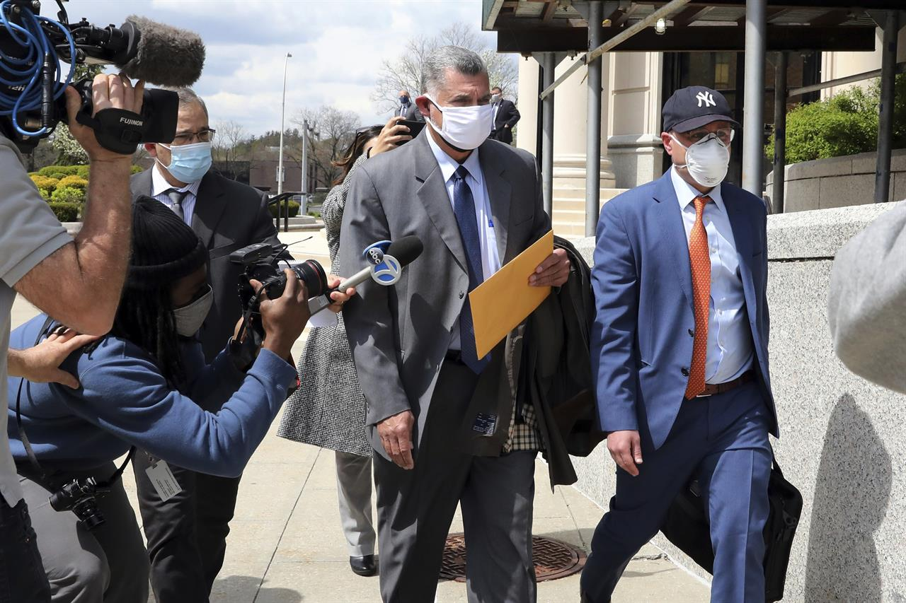Former police lieutenant-turned-lawyer Gustavo Vila, center, leaves federal court in White Plains, N.Y., on Monday, April 19, 2021. Vila was sentenced to more than four years in prison after cheating a fellow officer of $900,000 he was owed for working at the smoldering World Trade Center site after the Sept. 11 terrorist attacks. (Tania Savayan/The Journal News via AP)
