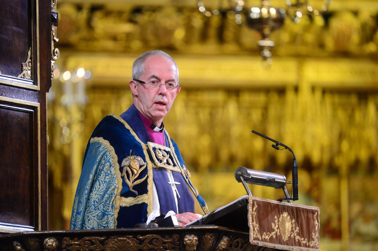FILE - In this Sunday Nov. 11, 2018 file photo, Archbishop of Canterbury Justin Welby makes an address during a National Service to mark the centenary of the Armistice at Westminster Abbey, London. A report published Thursday April 22, 2021 aiming to tackle racism in the Church of England has recommended dozens of proposals to end decades of inaction, including the requirement that at least one ethnic minority candidate be included in shortlists for senior clergy roles. (Paul Grover/Pool photo via AP)