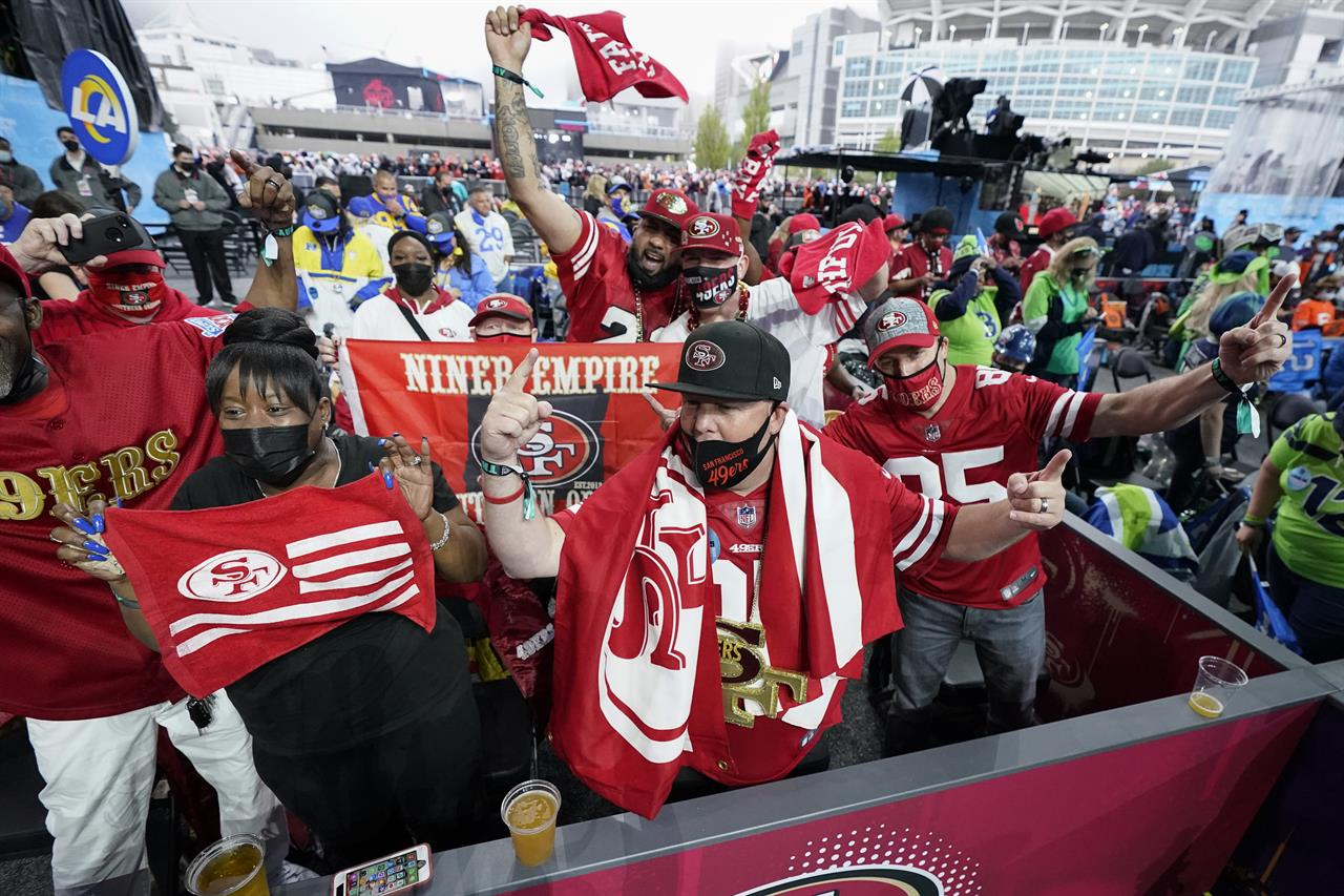A group of San Francisco 49ers fans cheer as they await the NFL football draft, Thursday, April 29, 2021, in Cleveland. (AP Photo/Tony Dejak)