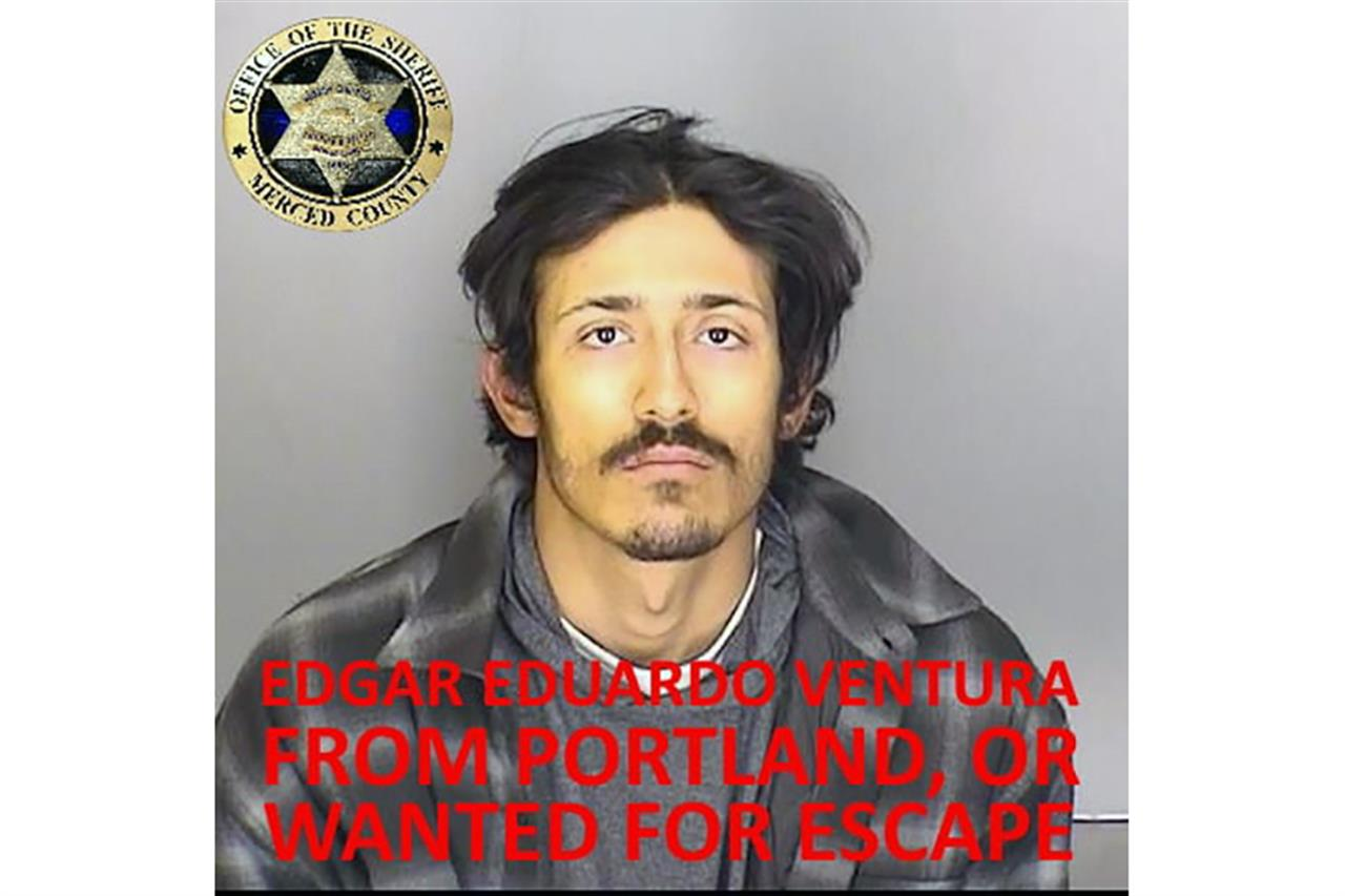"This undated booking photo released by the Merced County Sheriff's Office shows escapee inmate Edgar Eduardo Ventura, from Portland, Ore. Authorities in central California are searching for six inmates, including Ventura, who used a ""homemade rope"" to escape from a county jail. The Merced County Sheriff's Office says all six should be considered armed and dangerous. Staff at Merced County Downtown Jail noticed late Saturday, Jan.10, 2021, that the six inmates were missing. (Merced County Sheriff's Office via AP)"