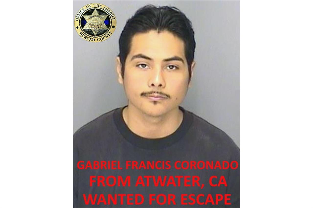 "This undated booking photo released by the Merced County Sheriff's Office shows escapee inmate Gabriel Francis Coronado, from Atwater, Calif. Authorities in central California are searching for six inmates, including Coronado, who used a ""homemade rope"" to escape from a county jail. The Merced County Sheriff's Office says all six should be considered armed and dangerous. Staff at Merced County Downtown Jail noticed late Saturday, Jan. 10, 2021, that the six inmates were missing. (Merced County Sheriff's Office via AP)"