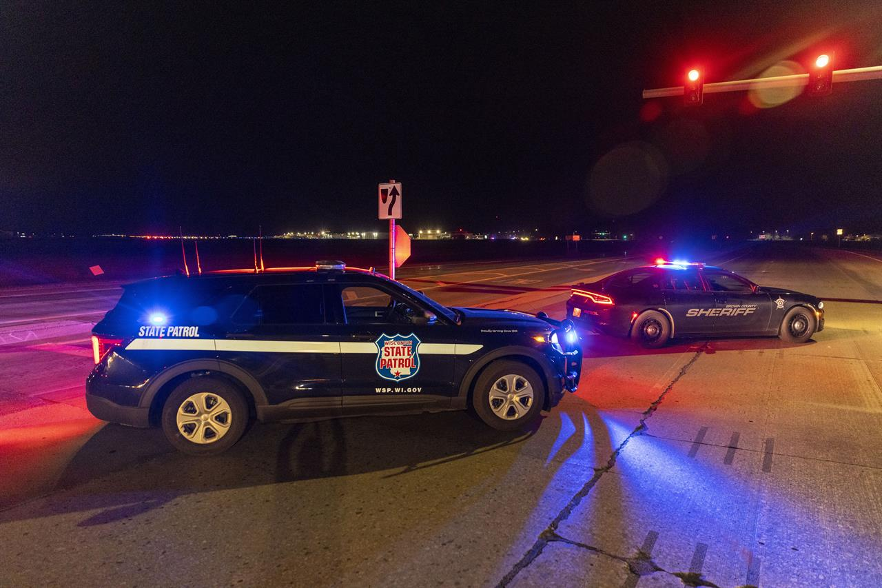 Law enforcement blocks the road in front of the Oneida Bingo and Casino in Green Bay, Wis on Saturday May 1, 2021 after reports of an active shooter. A spokesperson for a Wisconsin casino says an undetermined number of people have been shot at the casino. The Oneida Casino in Green Bay tweeted Saturday there was an active shooter at the casino.  (AP Photo/Mike Roemer)