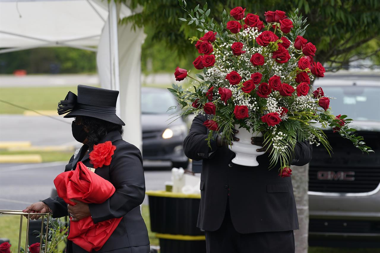 Flowers arrive ahead of the funeral for Andrew Brown Jr., Monday, May 3, 2021 at Fountain of Life Church in Elizabeth City, N.C. Brown was fatally shot by Pasquotank County Sheriff deputies trying to serve a search warrant. (AP Photo/Gerry Broome)