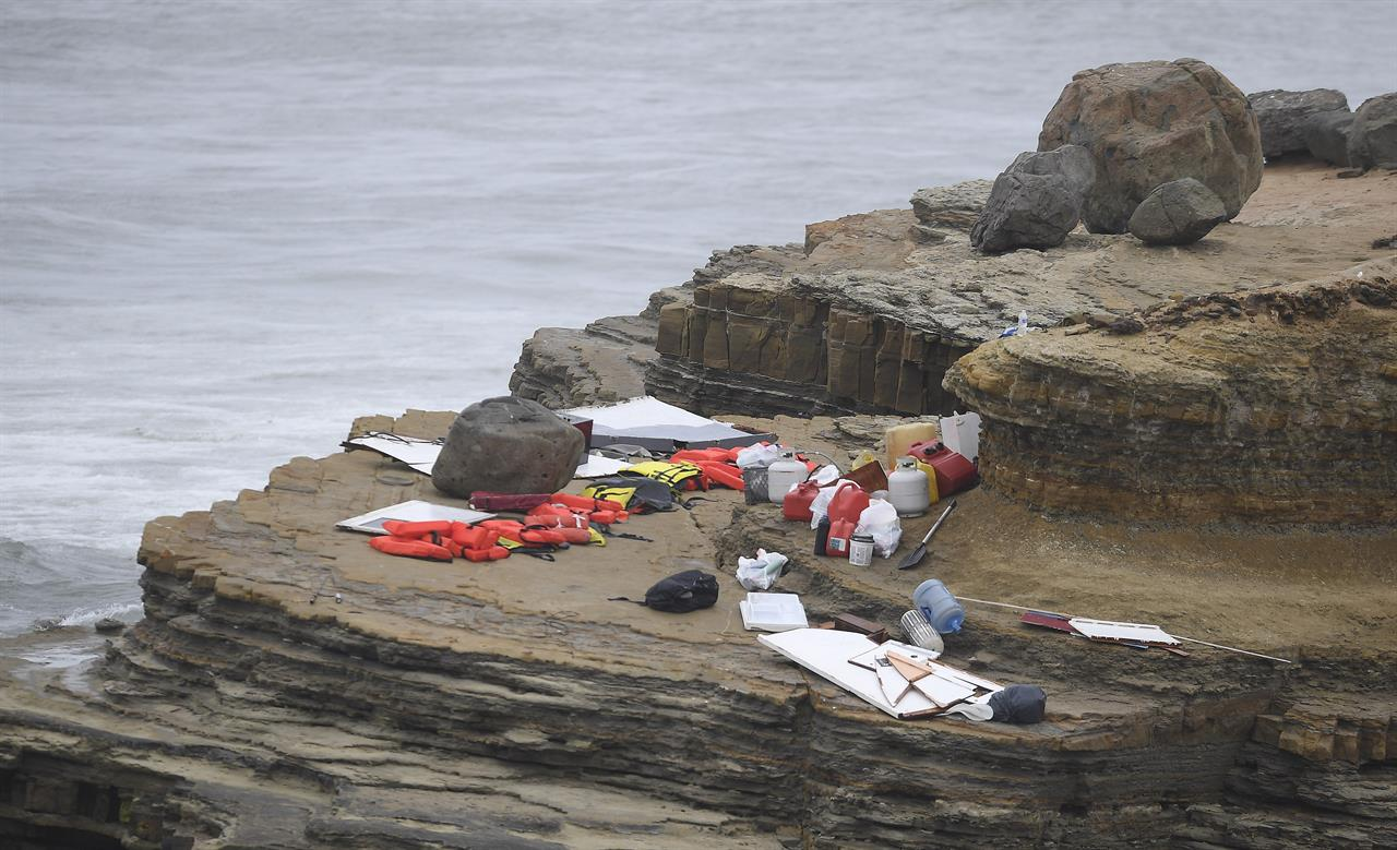 Items from a boat sit on the shoreline at Cabrillo National Monument near where it capsized just off the San Diego coast Sunday, May 2, 2021, in San Diego. Authorities say two people were killed and nearly two dozen others were hospitalized after the boat capsized. (AP Photo/Denis Poroy)