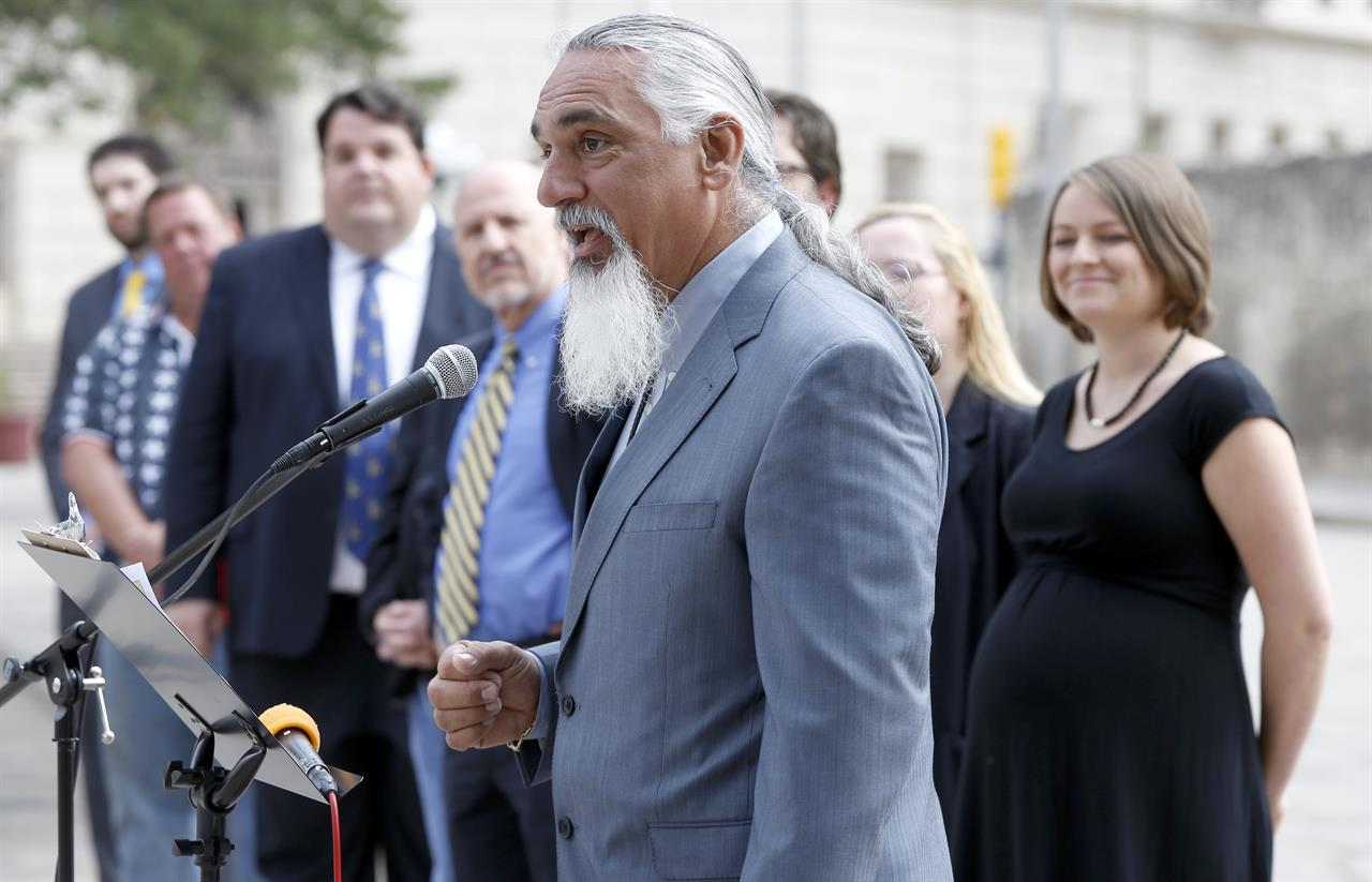 """FILE - In this May 1, 2014 file photo, Libertarian party candidate for Texas attorney general Jamie Balagia speaks in front of the Alamo in San Antonio, Texas, about his election platform. Balagia, a Texas lawyer known as the """"DWI Dude"""" has been sentenced to more than 15 years in federal prison for falsely promising Colombian drug traffickers he'd get their charges reduced in exchange for cash.  Balagia was sentenced Monday, May, 3, 2021, to 188 months in federal prison. (William Luther/The San Antonio Express-News via AP)"""