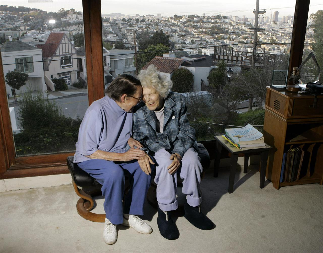FILE - In this March 3, 2008, file photo, Phyllis Lyon, left, and Del Martin are photographed at home in San Francisco. The hilltop cottage of the couple that became the first same-sex partners to legally marry in San Francisco has become a city landmark. The San Francisco Board of Supervisors voted unanimously Tuesday, May 4, 2021, to give the 651 Duncan St. home of the lesbian activists landmark status. The home in the Noe Valley neighborhood is expected to become the first lesbian landmark in the western United States, the San Francisco Chronicle reported. (AP Photo/Marcio Jose Sanchez, file)