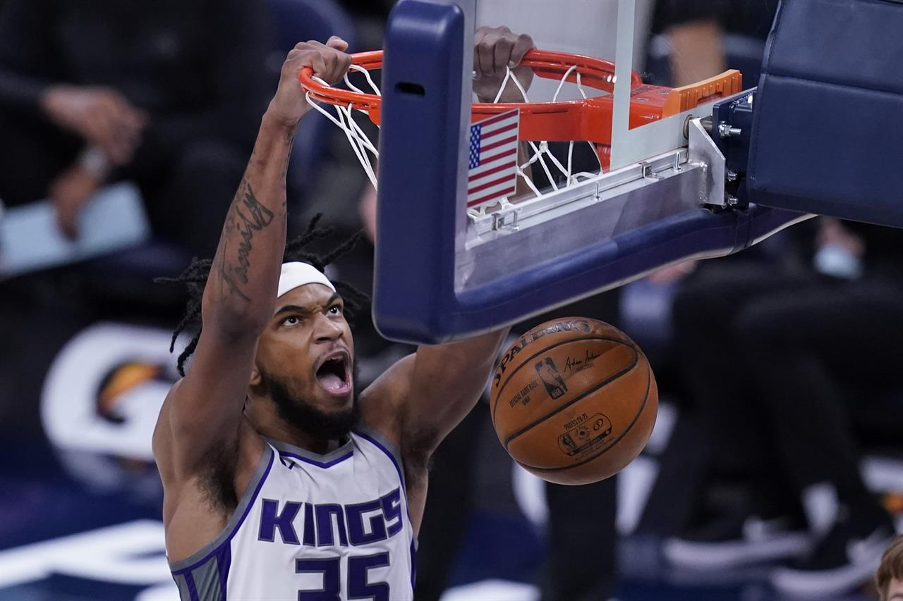 Sacramento Kings' Marvin Bagley III dunks during the first half of the team's NBA basketball game against the Indiana Pacers, Wednesday, May 5, 2021, in Indianapolis. (AP Photo/Darron Cummings)