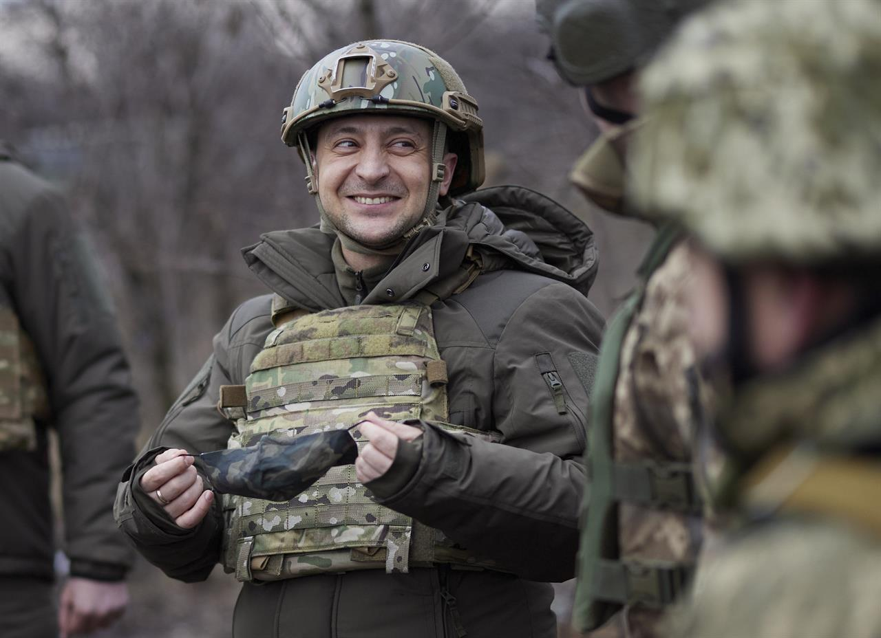 FILE - In this Thursday, Feb. 11, 2021 file photo, Ukrainian President Volodymyr Zelenskyy talks with servicemen as he visits the war-hit Donetsk region, eastern Ukraine. On the frontlines of the battle against Russia-backed separatists and in the halls of government in Kyiv, Ukrainians hold strong hopes for the visit of the U.S. Secretary of State — increased military aid and strong support for NATO membership among them. (Ukrainian Presidential Press Office via AP, File)