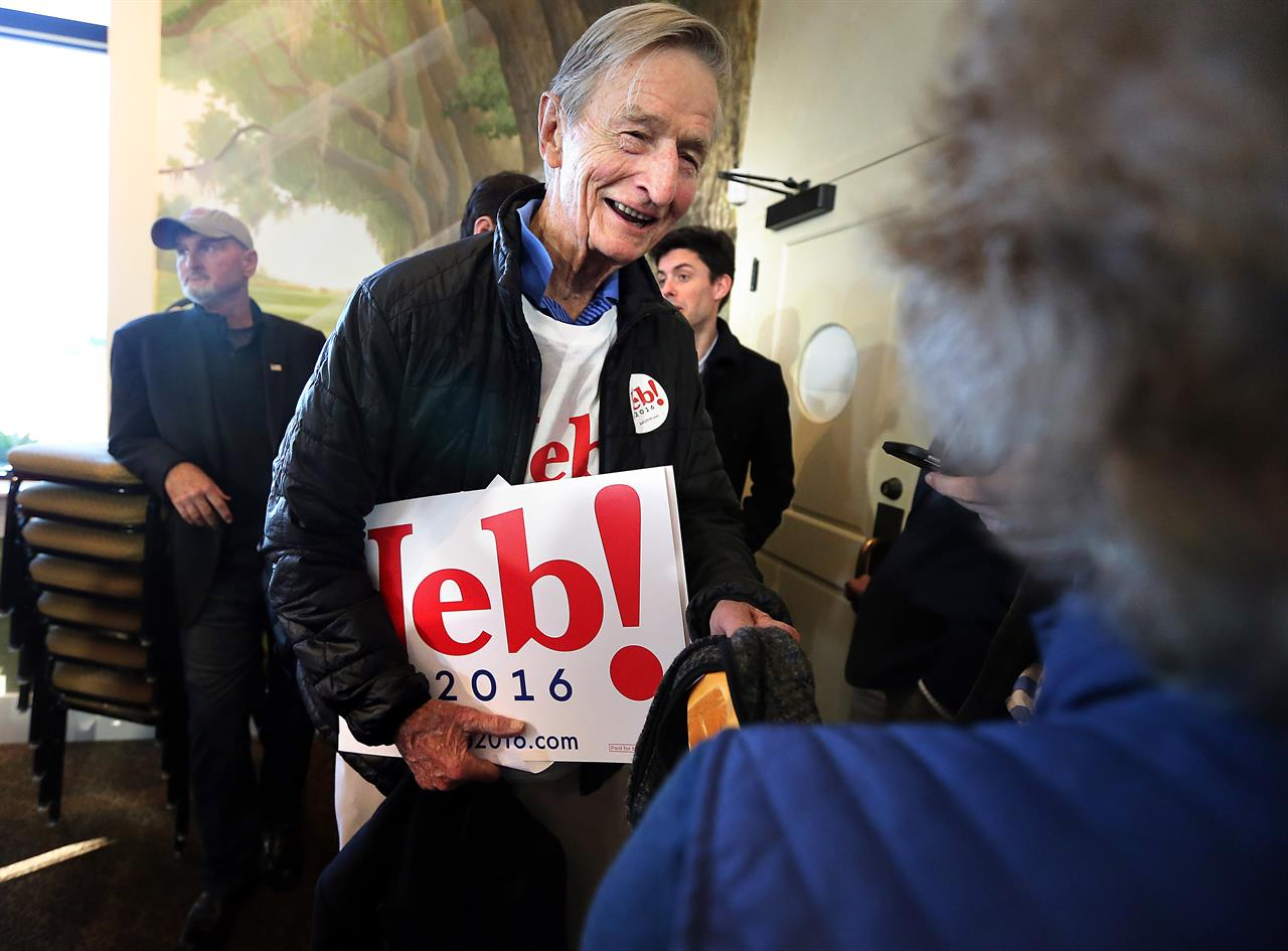 FILE - In this Feb. 10, 2016, file photo, Jonathan Bush, talks at a campaign event at Mount Pleasant's Memorial Waterfront Park with signs for his nephew, former Florida Gov. Jeb Bush. Bush, the younger brother of the late President George H.W. Bush and uncle of former President George W. Bush, died on Wednesday, May 5, 2021. (Wade Spees/The Post And Courier via AP)