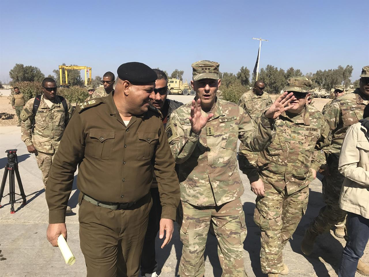 FILE - In this Feb. 8, 2017, file photo, then-Army Lt. Gen. Stephen Townsend talks with an Iraqi officer during a tour north of Baghdad, Iraq. Townsen, now a general, says a growing military threat from China may well come from America's east, as Beijing looks to establish a large navy port capable of hosting submarines or aircraft carriers on the Atlantic coast of Africa.(AP Photo/ Ali Abdul Hassan, File)