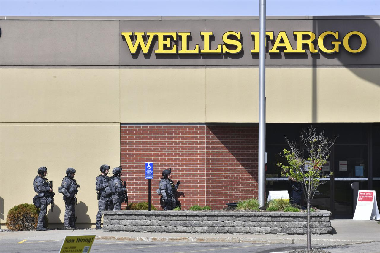 SWAT team officers respond to the scene of a reported hostage situation at the Wells Fargo branch Thursday May 6, 2021, in south St. Cloud, Minn. Police in Minnesota were on the scene Thursday of a reported bank robbery with hostages. (Dave Schwarz/St. Cloud Times via AP)