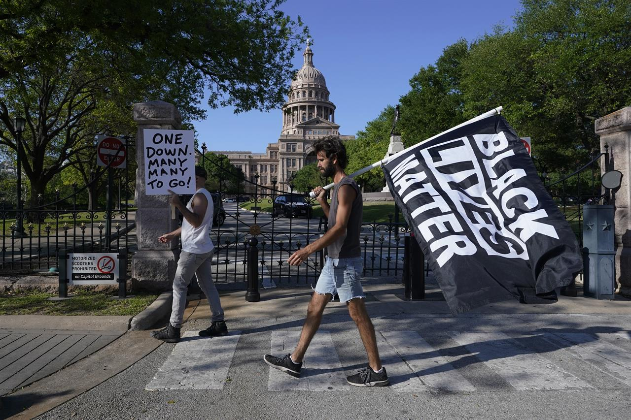 People gather at the Texas Capitol, Tuesday, April 20, 2021, in Austin, Texas, after the guilty verdict in the murder trial of former Minneapolis police Officer Derek Chauvin, in the death of George Floyd, was announced. (AP Photo/Eric Gay)