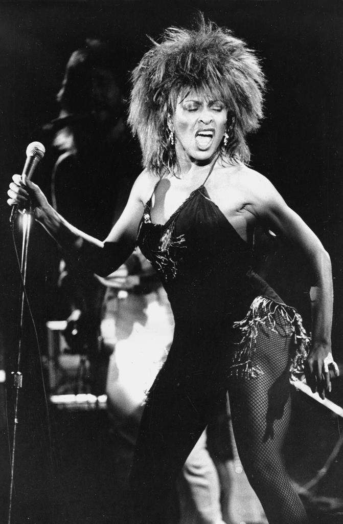 """FILE - Tina Turner performs her current hit song """"What's Love Got to Do With It"""" in Los Angeles on Sept. 2, 1984. Turner will be inducted to the Rock & Roll Hall of Fame. The ceremony, to be held at the Rocket Mortgage Fieldhouse in Cleveland, will be simulcast on SiriusXM and air later on HBO. (AP Photo/Phil Ramey, File)"""