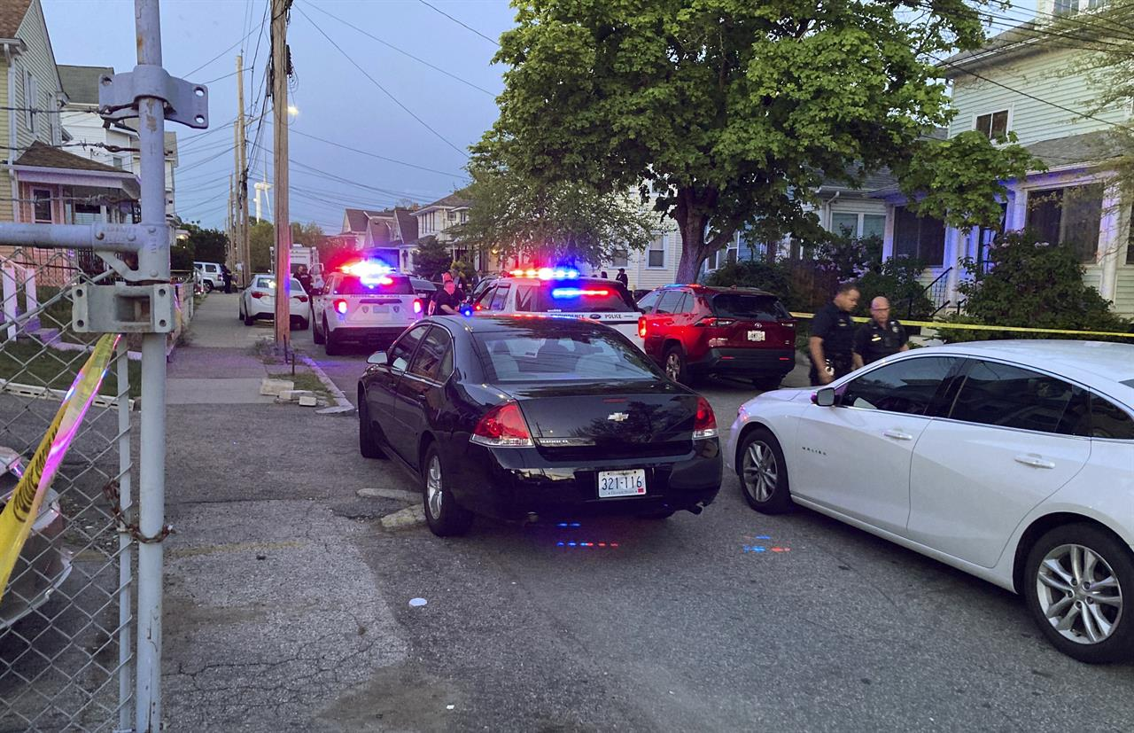 Authorities respond to the scene where multiple people were wounded in a shooting, Thursday, May 13, 2021, in Providence, R.I. (AP Photo/William J. Kole)