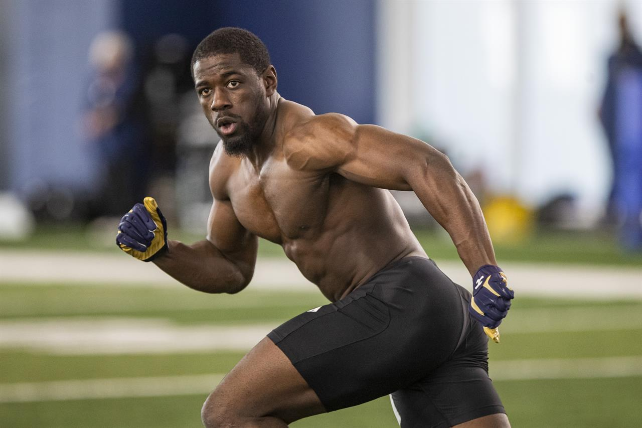 """FILE - Jeremiah Owusu-Koramoah participates in Notre Dame's Pro Day workout in South Bend, Ind., in this Wednesday, March 31, 2021, file photo. Browns rookie linebacker Jeremiah Owusu-Koramoah said he's not worried about a heart issue that may have caused some teams to pass on him in the NFL draft. """"My heart is 100% healthy,"""" Owusu-Koramoah said Friday, May 14, 2021, on a Zoom call as the Browns opened rookie minicamp. (AP Photo/Robert Franklin, File)"""
