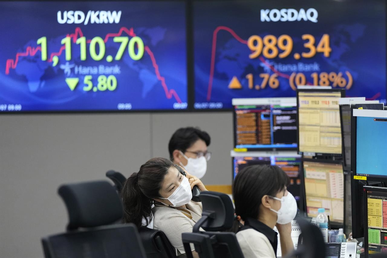 A currency trader talks on the phone at the foreign exchange dealing room of the KEB Hana Bank headquarters in Seoul, South Korea, Monday, June 7, 2021. Asian shares were mixed Monday, as initial euphoria about the gains that closed out last week on Wall Street faded quickly. (AP Photo/Ahn Young-joon)