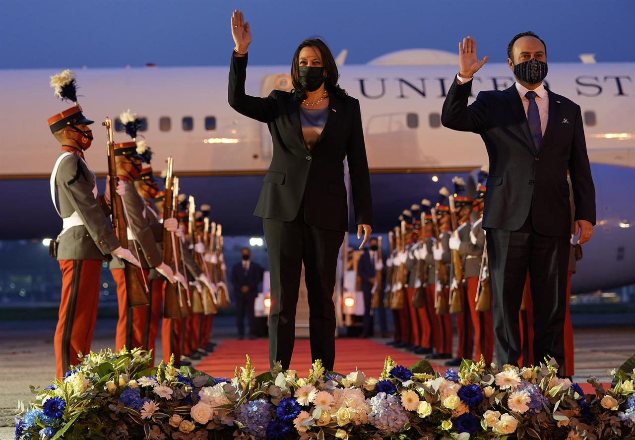Vice President Kamala Harris and Guatemala's Minister of Foreign Affairs Pedro Brolo wave at her arrival ceremony in Guatemala City, Sunday, June 6, 2021, at Guatemalan Air Force Central Command. (AP Photo/Jacquelyn Martin)