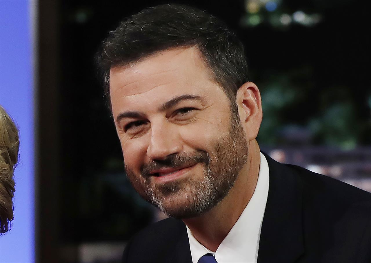 """FILE - In this Aug. 22, 2016, file photo, ABC talk show host Jimmy Kimmel poses with then Democratic presidential nominee Hillary Clinton, unseen, during a break in taping of """"Jimmy Kimmel Live!"""" in Los Angeles. Kimmel announced Wednesday, June 17, 2021, on his show that he will be the title sponsor of college football's LA Bowl that is scheduled to be played Dec. 18 at SoFi Stadium in Inglewood, Ca. (AP Photo/Carolyn Kaster, File)"""