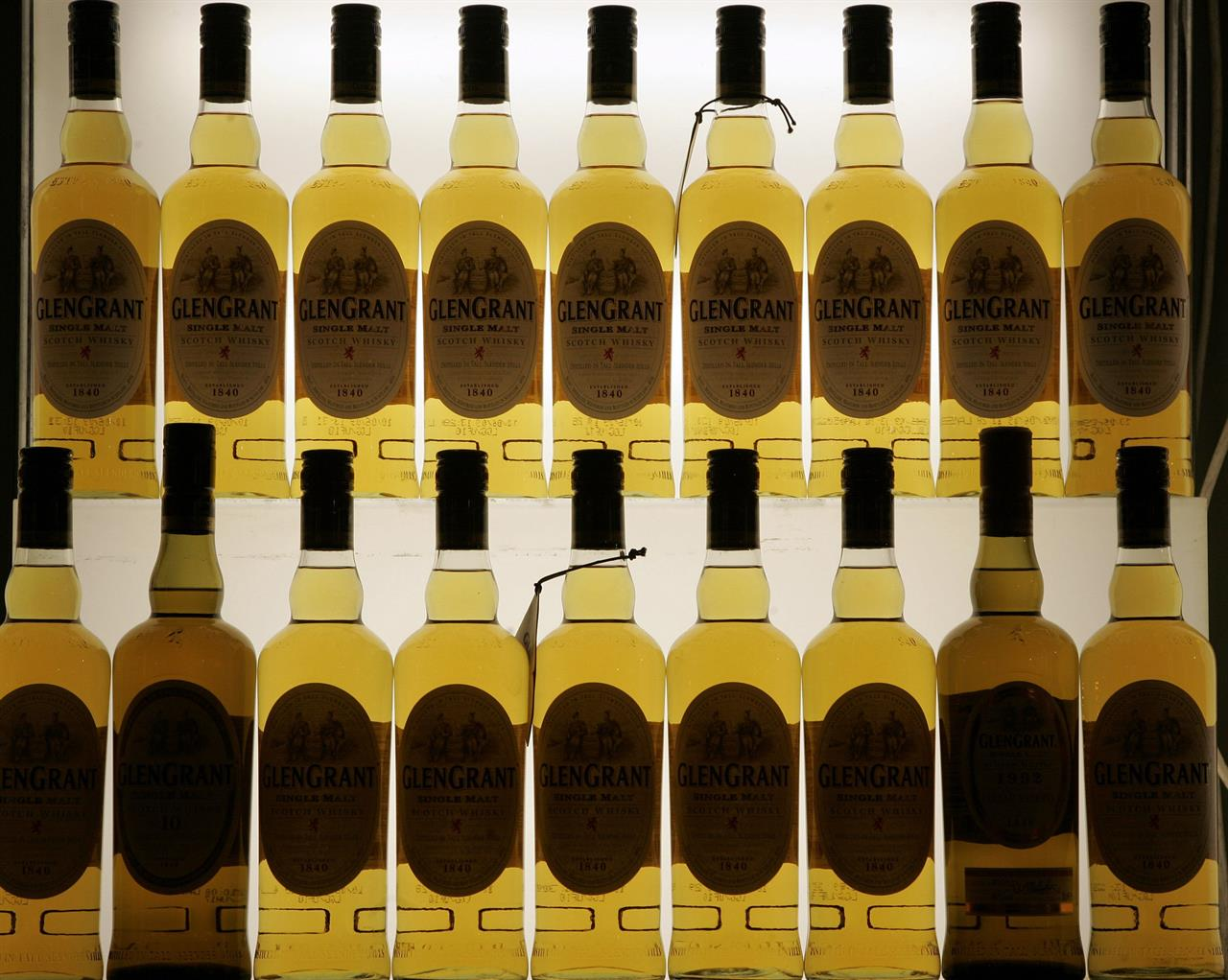 FILE- This Friday, Nov. 13, 2009, file photo, shows Scotch bottles in Cologne, Germany. Scotch whisky makers are breathing a sigh of relief after the United States agreed to suspend tariffs on one of Scotland's main exports. U.S. President Donald Trump imposed a 25% tariff on single malt Scotch whisky in 2019 as part of a trade dispute between the U.S. and EU countries over aerospace subsidies. (AP Photo/Hermann J. Knippertz, File)