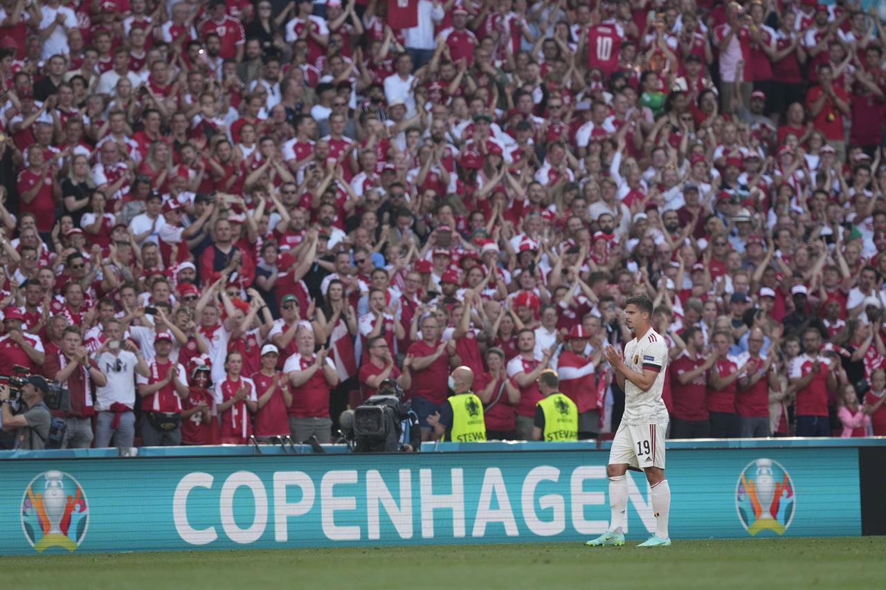 Belgium's Leander Dendoncker applauds as the Belgium team pays tribute to Denmark's Christian Eriksen in 10th minute during the Euro 2020 soccer championship group B match between Denmark and Belgium at Parken stadium in Copenhagen, Denmark, Thursday, June 17, 2021. (AP Photo/Martin Meissner, Pool)