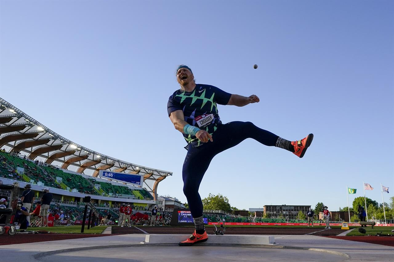 Ryan Crouser competes during the finals of men's shot put at the U.S. Olympic Track and Field Trials Friday, June 18, 2021, in Eugene, Ore. (AP Photo/Charlie Riedel)