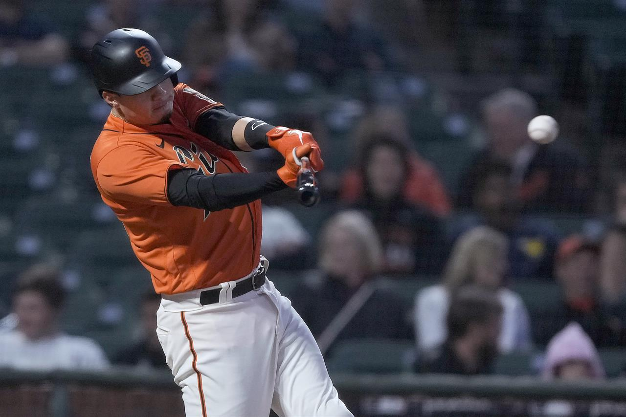 San Francisco Giants' Wilmer Flores hits a single against the Philadelphia Phillies during the fifth inning of a baseball game Friday, June 18, 2021, in San Francisco. (AP Photo/Tony Avelar)