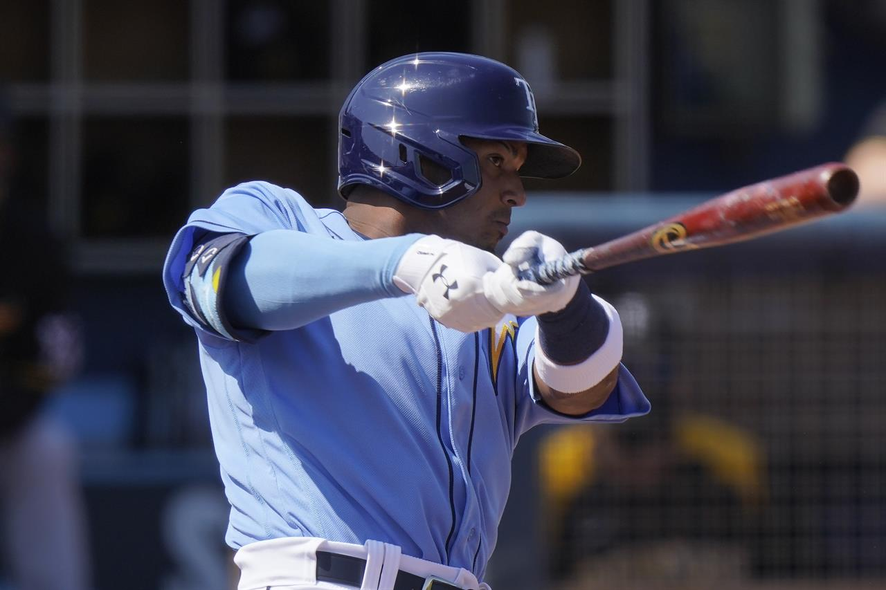 FILE - In this March 3, 2021, file photo, Tampa Bay Rays' Wander Franco hits a home run in the first inning during a spring training baseball game against the Pittsburgh Pirates in Port Charlotte, Fla. Franco is being called up to make his major league debut against Boston on Tuesday, June 22, 2021. He is regarded as the top prospect in the minor leagues. (AP Photo/Brynn Anderson, File)