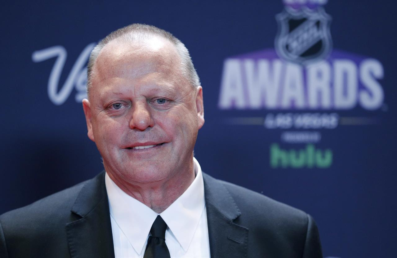 """FILE - Gerard Gallant, head coach of the Vegas Golden Knights, poses on the red carpet before the NHL Awards in Las Vegas, in this Wednesday, June 20, 2018, file photo. Gallant takes on a new challenge as coach of the New York Rangers, looking to """"take a big step"""" with a young team that ownership and management thinks should be a contender. It's very different than his previous stints with expansion Vegas and Florida. (AP Photo/John Locher, File)"""
