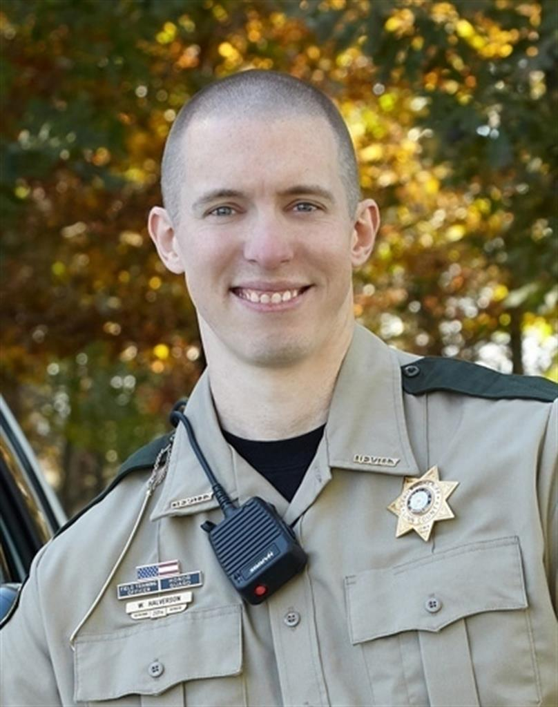 This photo provided by Linn County, Iowa sheriff's office shows deputy William Halverson.  A criminal complaint released Tuesday, June 22, 2021,  says Linn County Deputy William Halverson was wearing a protective vest but was shot by Stanley Donahue in the left hip and leg while responding to a robbery Sunday night at the Casey's General Store in Coggon, Iowa.  (Linn County, Iowa Sheriff's Office via AP)