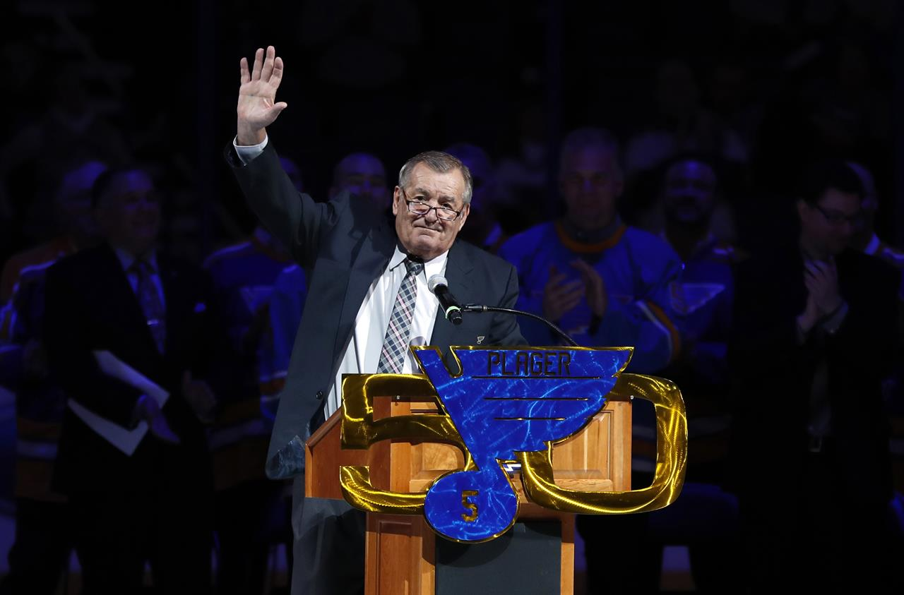 """FILE - In this Thursday, Feb 2, 2017 file photo, former St. Louis Blues player Bob Plager waves to fans while speaking during a ceremony to retire his number before an NHL hockey game in St. Louis. The final report on the cause of death Bob Plager has confirmed that he died of a """"cardiac event"""" before crashing his SUV in March 2021. St. Louis Medical Examiner Dr. Michael Graham revealed the final report on Tuesday, June 23, 2021, confirminghis preliminary findingsfrom shortly after Plager's death. (AP Photo/Jeff Roberson, File)"""