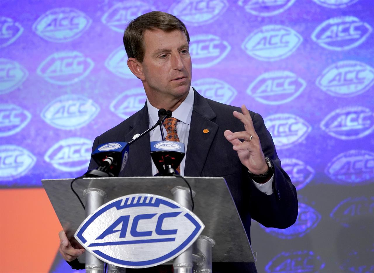 FILE - Clemson head coach Dabo Swinney speaks during the Atlantic Coast Conference NCAA college football media day in Charlotte, N.C., in this Wednesday, July 17, 2019, file photo. The post-Trevor Lawrence era begins at Clemson with the Tigers still the prohibitive favorites to win the Atlantic Coast Conference for a seventh straight season. On the latest AP Top 25 Podcast, David Hale from ESPN joins AP's Ralph Russo to preview the ACC from Clemson at the top to Syracuse at the bottom.(AP Photo/Chuck Burton, File)