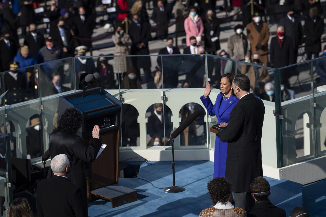 Kamala Harris is sworn in as vice president by Supreme Court Justice Sonia Sotomayor as her husband Doug Emhoff holds the Bible during the 59th Presidential Inauguration at the U.S. Capitol in Washington, Wednesday, Jan. 20, 2021. (Caroline Brehman/Pool Photo via AP)