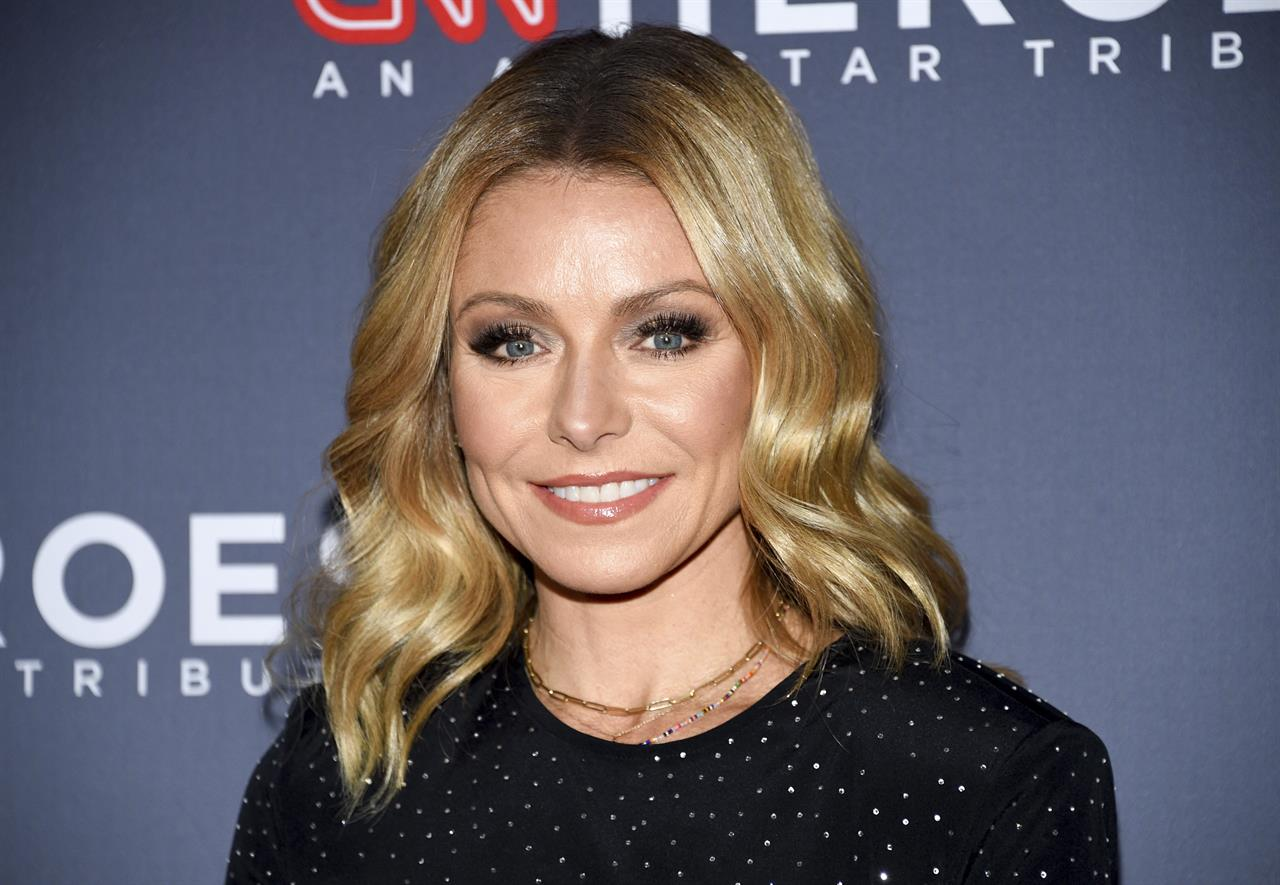 """FILE - In this Dec. 9, 2018 file photo, Host Kelly Ripa attends the 12th annual CNN Heroes: An All-Star Tribute at the American Museum of Natural History in New York. Ripa is now an author.  Dey Street Books, a HarperCollins Publishers imprint, announced Tuesday, July 20, 2021, that Ripa's essay collection """"Live Wire"""" will come out next year.  (Photo by Evan Agostini/Invision/AP, File)"""