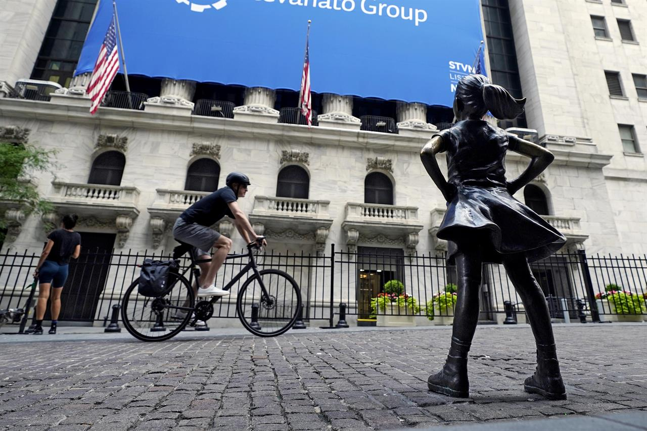 The Fearless Girl statue faces the New York Stock Exchange, Tuesday, July 20, 2021. (AP Photo/Richard Drew)