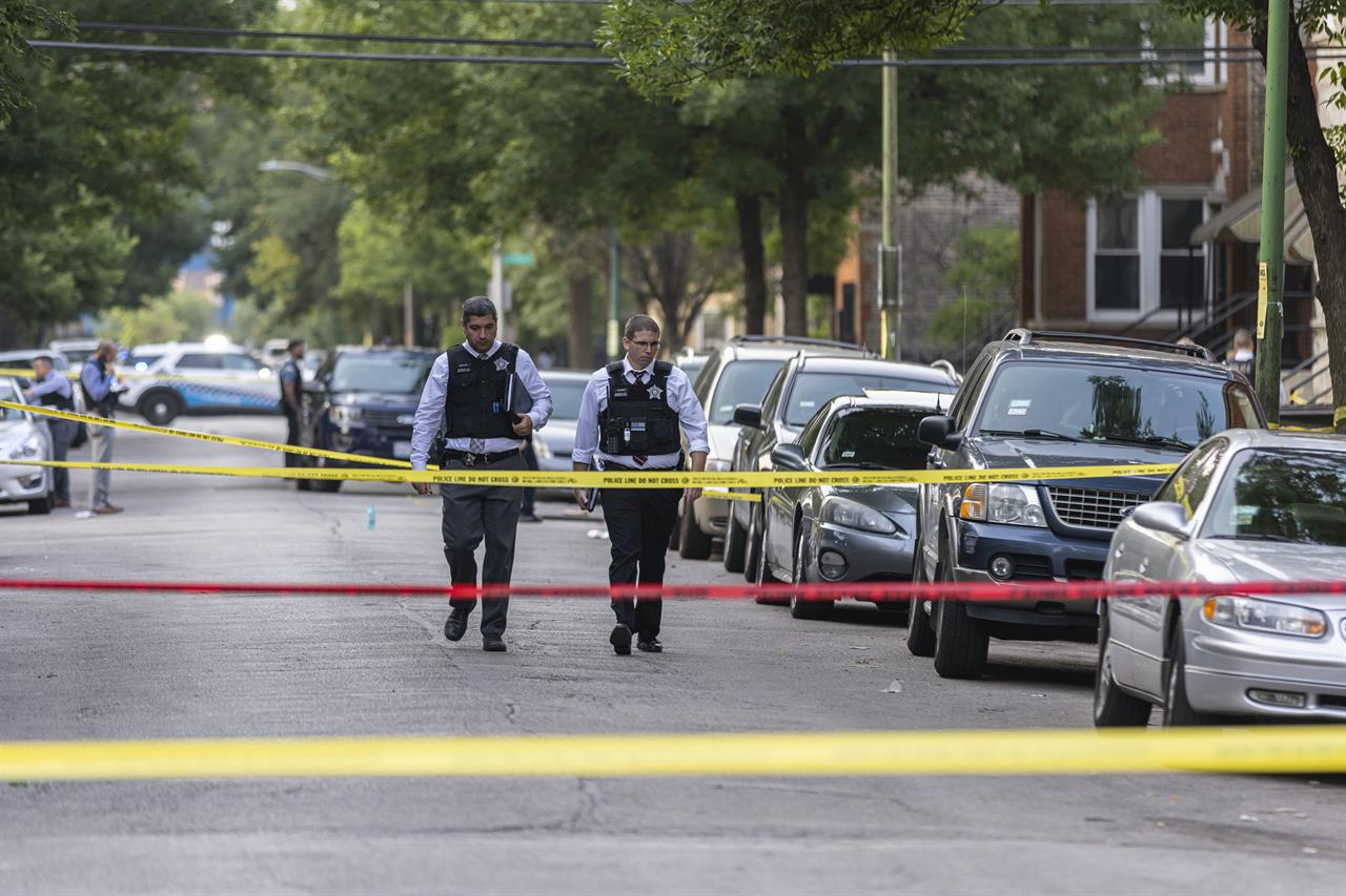 Police investigate the scene of a shooting near 1324 S Christiana Ave in Lawndale, on Chicago's West Side, Wednesday, July 21, 2021. (Anthony Vazquez/Chicago Sun-Times via AP)