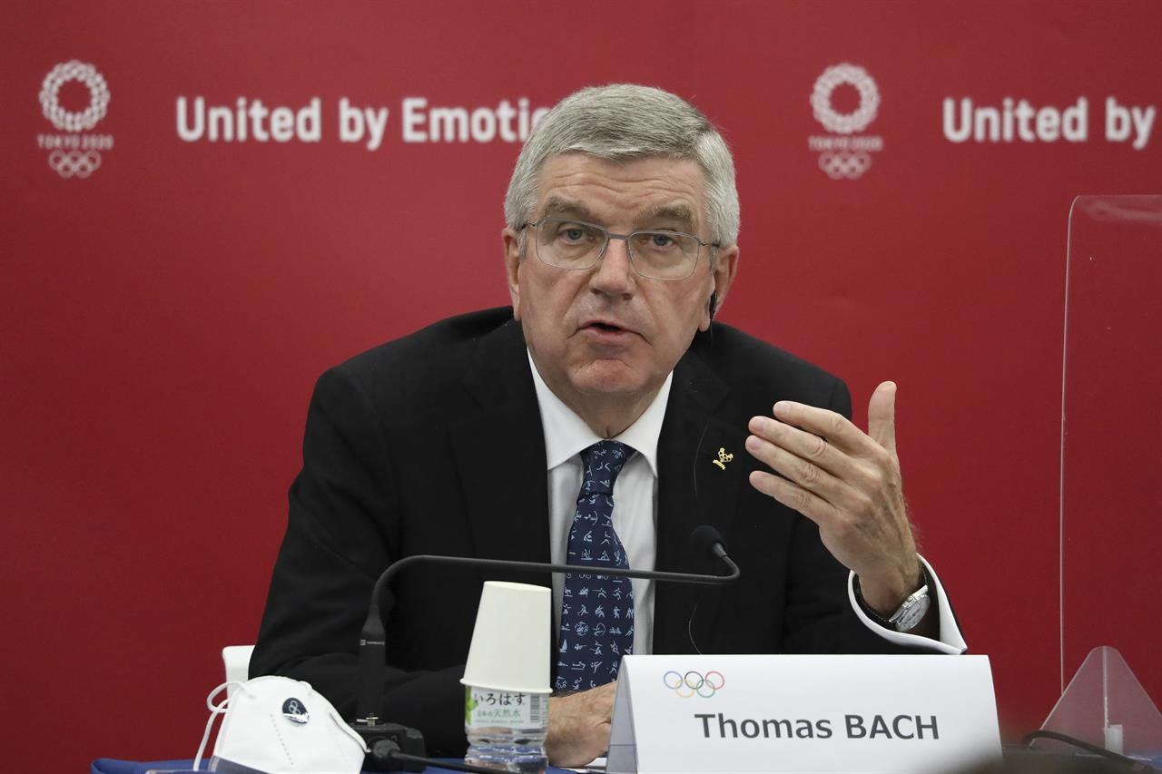 FILE - In this Nov. 16, 2020, file photo, ThomasBach, International Olympic Committee (IOC) President,speaks during the joint press conference between IOC and Tokyo Organizing Committee of the Olympic and Paralympic Games (Tokyo 2020) in Tokyo, Japan. The International Olympic Committee is pushing back against reports that the postponed Tokyo Olympics will be canceled and will not open on July 23. The Tokyo Games were postponed 10 months ago at the outbreak of the coronavirus pandemic, and now their future appears threatened again.(DuXiaoyi/Pool Photo via AP, File)