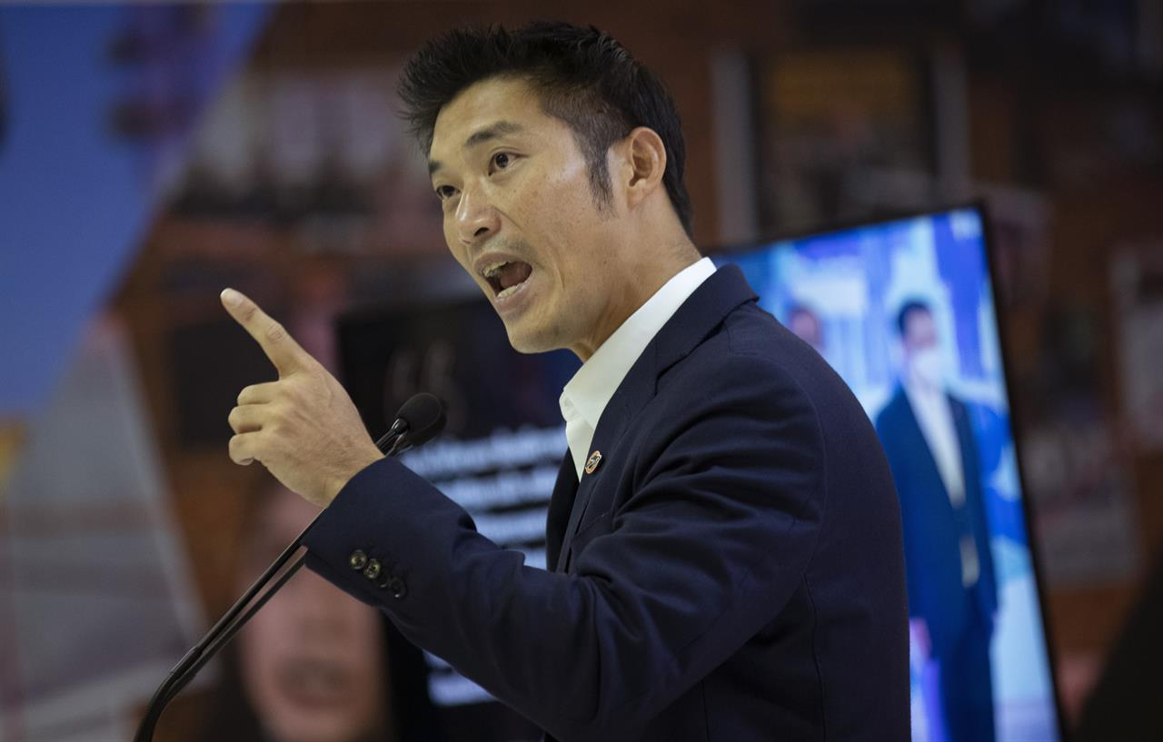 Former leader of the dissolved Future Forward Party, Thanathorn Juangroongruangkit speaks during a press conference in Bangkok, Thailand, Thursday, Jan. 21, 2021. Thanathorn was charged with defaming Thailand's monarchy by questioning the government's procurement of COVID-19 vaccines is standing by his comments and saying the nation deserves more transparency. (AP Photo/Sakchai Lalit)