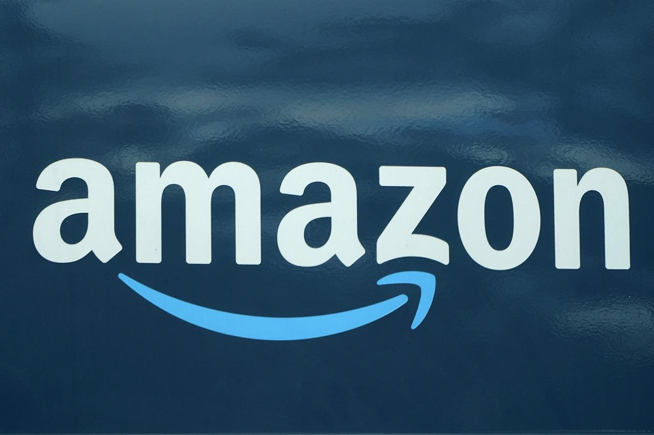 FILE - An Amazon logo appears on an Amazon delivery van, Thursday, Oct. 1, 2020, in Boston. Amazon won't be forced to restore web service to Parler after a federal judge ruled Thursday, Jan. 21, 2021 against a plea to reinstate the fast-growing social media app favored by followers of former President Donald Trump. (AP Photo/Steven Senne, file)