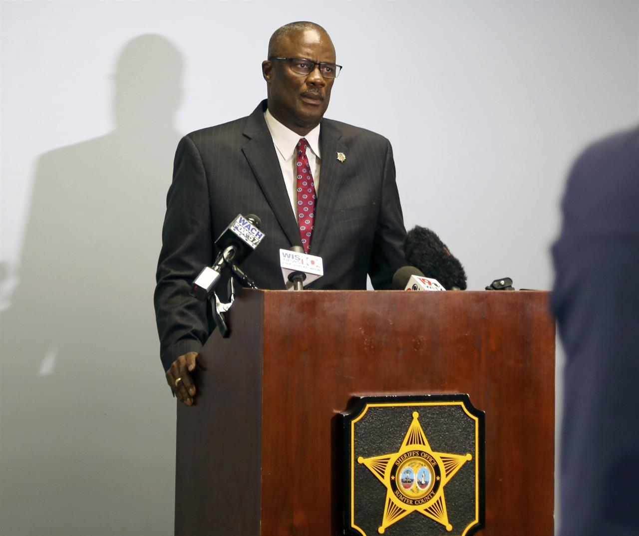Sumter County Sheriff Anthony Dennis releases the names of two people found shot to death near Interstate 95 more than 44 years ago at a news conference on Thursday, Jan. 21, 2021, in Sumter, S.C. DNA testing helped identify the victims, whose killer has not been found. (Kayla Green/The Item via AP)
