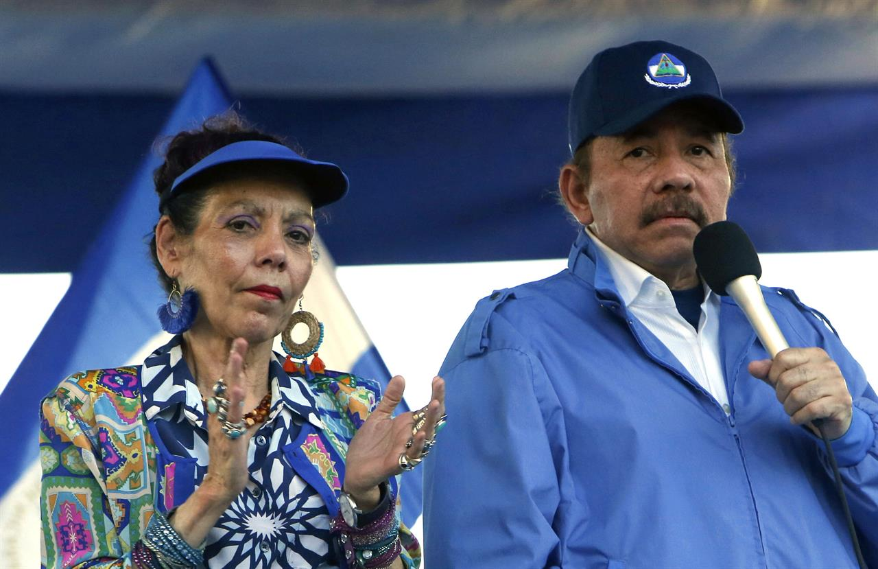 FILE - In this Sept. 5, 2018 file photo, Nicaragua's President Daniel Ortega and his wife, Vice President Rosario Murillo, lead a rally in Managua, Nicaragua. The European Union on Monday, Aug. 2, 2021 slapped sanctions on Nicaraguan first lady and seven other senior officials accused of serious human rights violations or undermining democracy, amid a crackdown on opposition politicians in the Central American country. (AP Photo/Alfredo Zuniga, File)