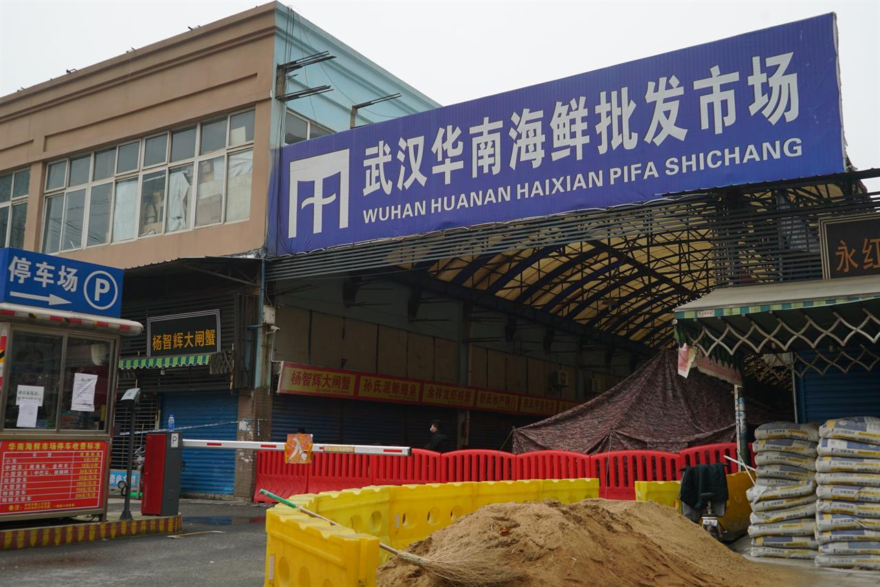 FILE - In this Jan. 21, 2020, file photo, the Wuhan Huanan Wholesale Seafood Market, where a number of people related to the market fell ill with a virus, sits closed in Wuhan in central China's Hubei province. The Chinese city of Wuhan is looking back on a year since it was placed under a 76-day lockdown beginning Jan. 23, 2020. (AP Photo/Dake Kang, File)