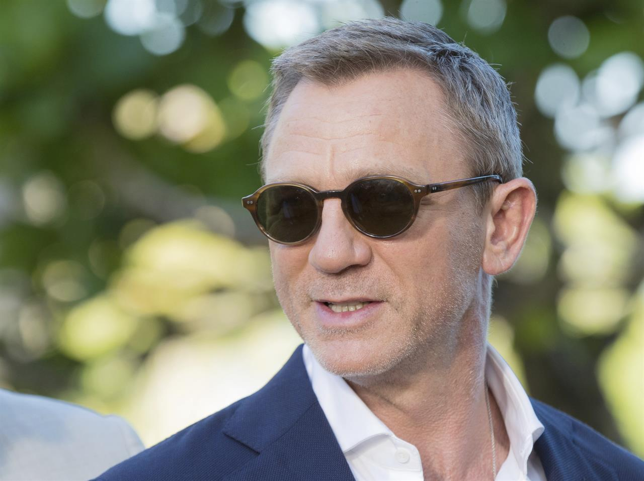 FILE - In this Thursday, Apriil 25, 2019 file photo, actor Daniel Craig poses for photographers during the photo call of the latest installment of the James Bond film franchise, in Oracabessa, Jamaica. Producers of the forthcoming James Bond thriller say the film's release has been delayed again, until the fall of 2021, because of the effects of the coronavirus pandemic. The official 007 Twitter account said late Thursday, Jan. 21, 2021 that the 25th installment in the franchise will now open on Oct. 8. (AP Photo/Leo Hudson, File)