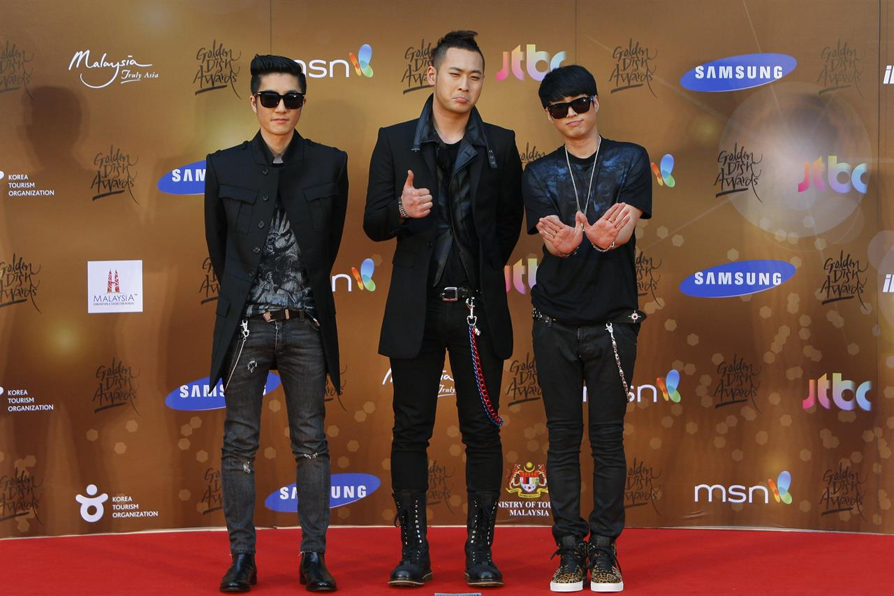 """FILE - In this Jan. 16, 2013, file photo, South Korean alternative hip-hop group Epik High poses for photographers as they arrive on the red carpet ahead of the 27th Golden Disk Awards at Sepang International Circuit in Sepang, Malaysia. Popular South Korean hip-hop trio Epik High was working on a song called """"End of the World"""" before the pandemic hit in 2020. Now, the band's frontman Tablo says, """"I wish that this song is not relevant."""" (AP Photo/Lai Seng Sin, File)"""