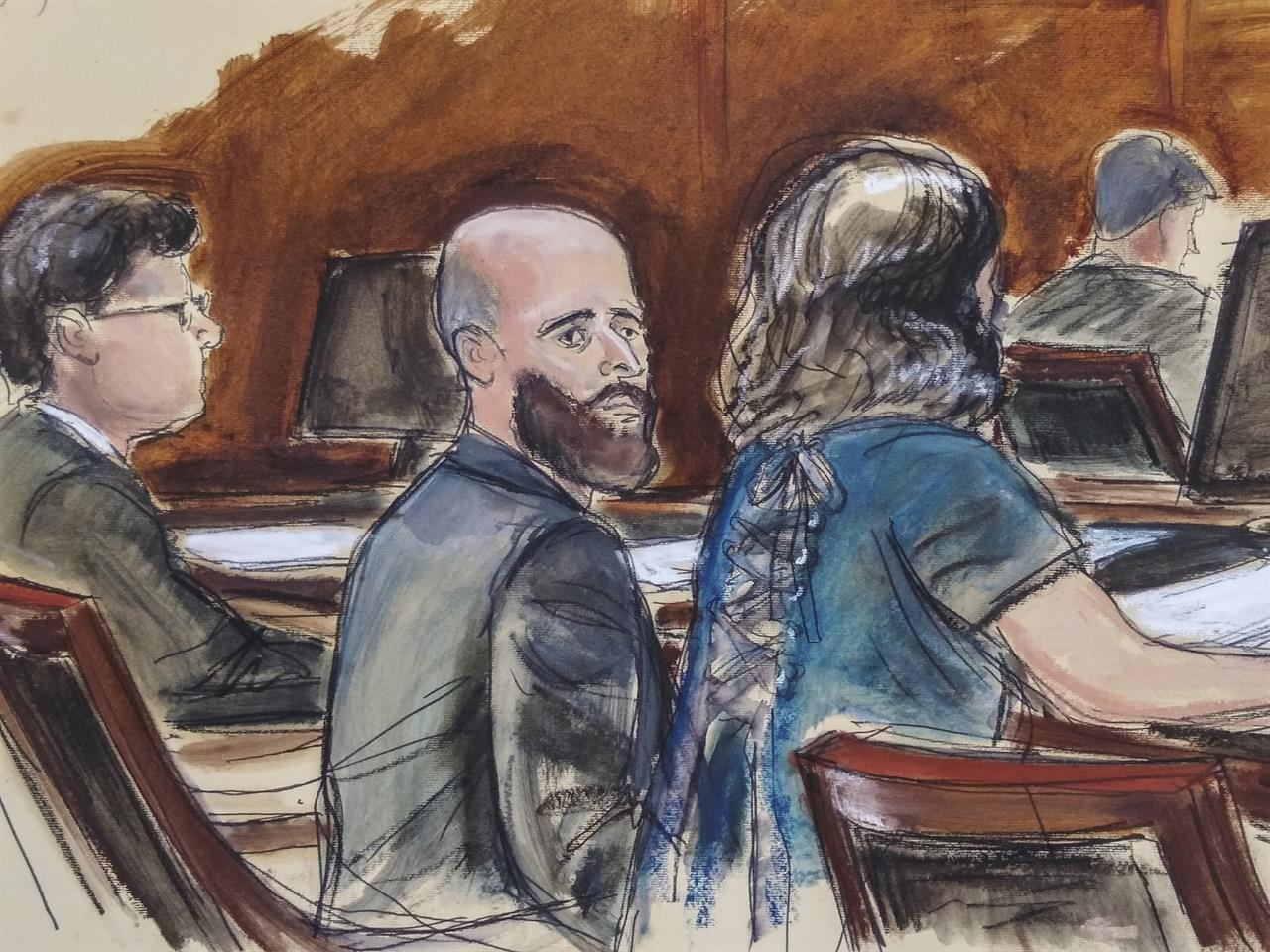 """In this Wednesday March 4, 2020 courtroom sketch Joshua Schulte, center, is seated at the defense table flanked by his attorneys during jury deliberations in New York. Joshua Schulte, a former CIA software engineer charged with leaking government secrets to WikiLeaks says it's cruel and unusual punishment that he's awaiting trial in solitary confinement, housed in a vermin-infested cell of a jail unit where inmates are treated like """"caged animals."""" In court papers Tuesday, Jan. 19, 2021 Schulte maintained he is held in conditions """"below that of impoverished persons living in third world countries."""" (Elizabeth Williams via AP)"""
