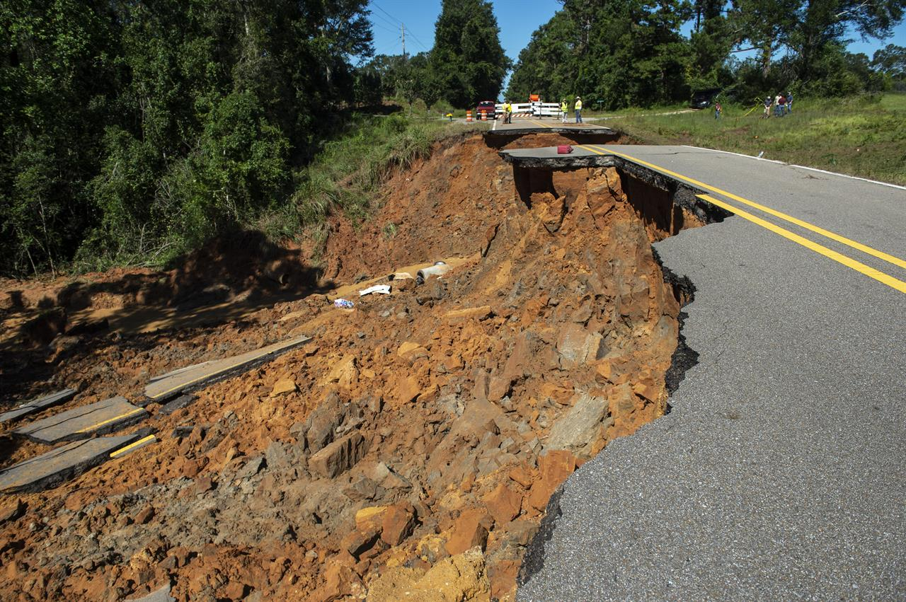 Part of Highway 26 washed away late Monday night, due to heavy rains from Hurricane Ida in the Benndale community in George County, Tuesday, Aug. 31, 2021. (Hannah Ruhoff/The Sun Herald via AP)