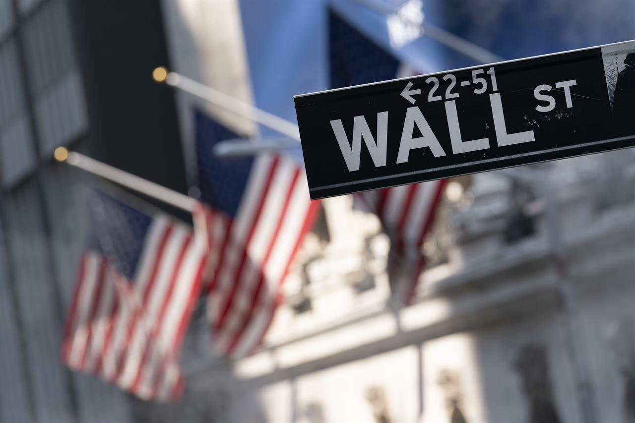 A sign for Wall Street hangs in front of the New York Stock Exchange, July 8, 2021. Stocks edged lower in morning trading, quickly reversing course after a brief gain following the latest data on inflation. Communications and industrial companies had some of the broadest losses, while health care stocks gained ground. U.S. consumer prices rose a lower-than-expected 0.3% last month, the smallest increase in seven months and a hopeful sign that inflation pressures may be cooling. (AP Photo/Mark Lennihan, file)