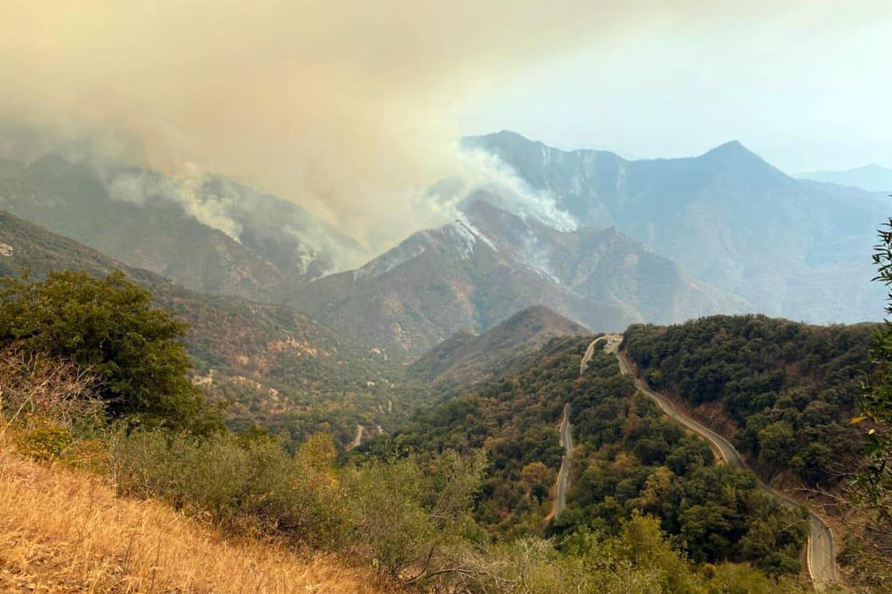 In this Sunday, Sept. 12, 2021 photo released by the KNP Complex Fire Incident Command, smoke plumes rise from the Paradise Fire in Sequoia National Park, Calif. In the southern Sierra Nevada, two fires ignited by lightning are burning in Sequoia National Park. (KNP Complex Fire Incident Command via AP)