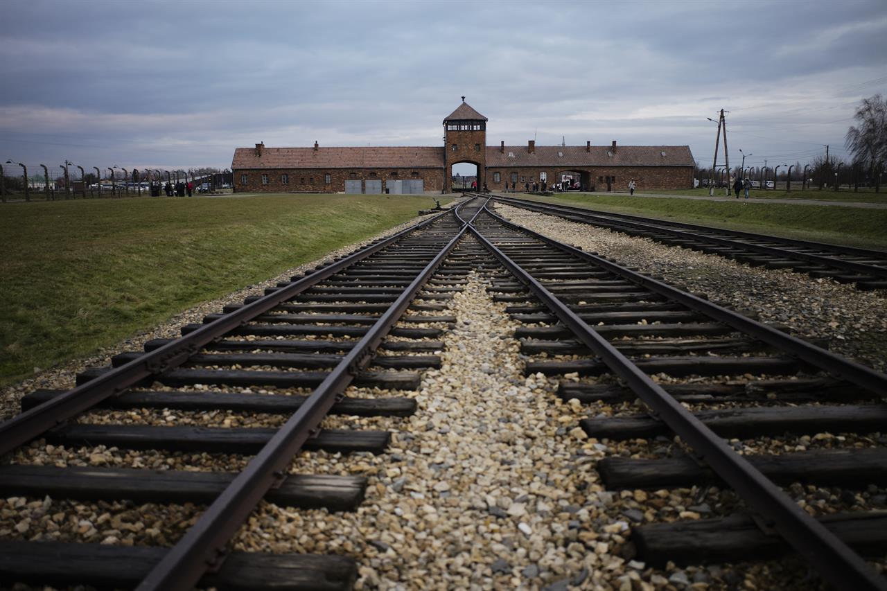The railway tracks from where hundred thousands of people was directed to the gas chambers to murdered immediately inside the former Nazi death camp of Auschwitz Birkenau or Auschwitz II. in Oswiecim, Poland, Saturday, Dec. 7, 2019. The commemorations for the victims of the Holocaust at the International Holocaust Remembrance Day, marking the liberation of Auschwitz-Birkenau on Jan. 27, 1945, will be mostly online in 2021 due to the coronavirus pandemic. (AP Photo/Markus Schreiber)