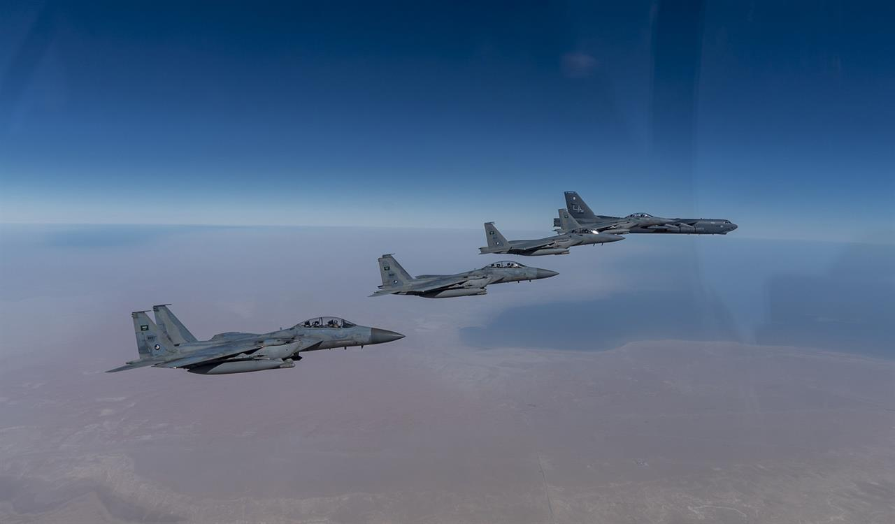 "In this Wednesday, Jan. 27, 2021 handout photo, released by the U.S. Air Force, a B-52 bomber from the 2nd Bomb Wing of Barksdale Air Force Base in Louisiana, right, flies with Royal Saudi Air Force F-15s during a mission in the Middle East. The U.S. military said Wednesday it again flew a B-52 bomber over the Middle East ""to deter potential aggression"" amid tensions with Iran. (U.S. Air Force/Senior Airman Roslyn Ward, via AP)"